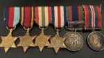 Toronto police are searching for the owners of these Second World War medals found during a drug investigation. (Toronto police handout)