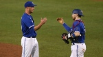 Toronto Blue Jays pitcher Patrick Murphy,left celebrates a victory over the Baltimore Orioles with teammate Danny Jansen following the ninth inning of a baseball game, Friday, Sept. 25, 2020, in Buffalo, N.Y. (AP Photo/Jeffrey T. Barnes)