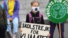 "Swedish climate activist Greta Thunberg holds a poster reading ""School strike for Climate"" as she protests in front of the Swedish Parliament Riksdagen, in Stockholm, Friday Sept. 4, 2020. The 17-year-old Swedish climate activist Greta Thunberg said Monday she is heading back to school after a year off, but has resumed her weekly protests outside Sweden's parliament. (Fredrik Sandberg / TT via AP)"