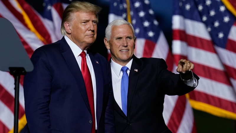 U.S. President Donald Trump, left, and Vice President Mike Pence look to the crowd during a campaign rally Friday, Sept. 25, 2020, in Newport News, Va. (AP / Steve Helber)