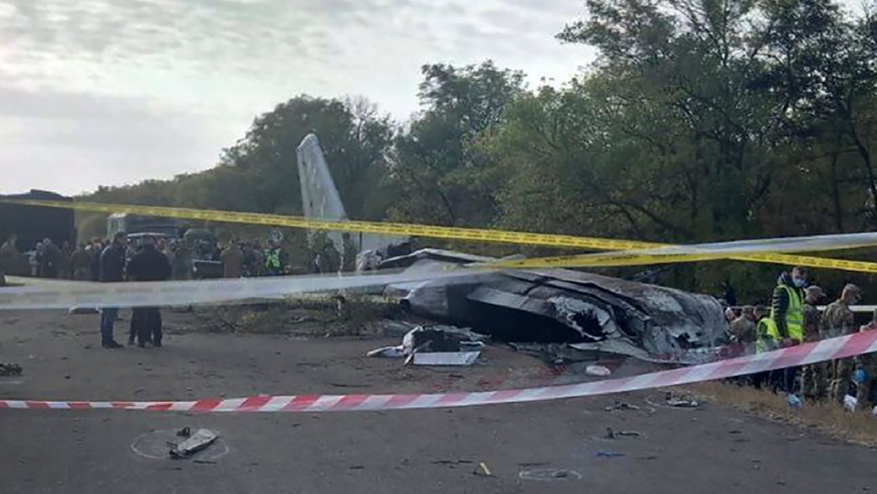 In this photo provided by the Emergency Situation Ministry, a view of the debris and remains of the AN-26 military plane which crashed on Friday night, in the town of Chuguyiv close to Kharkiv, Ukraine, Saturday Sept. 26, 2020. (Emergency Situation Ministry via AP)