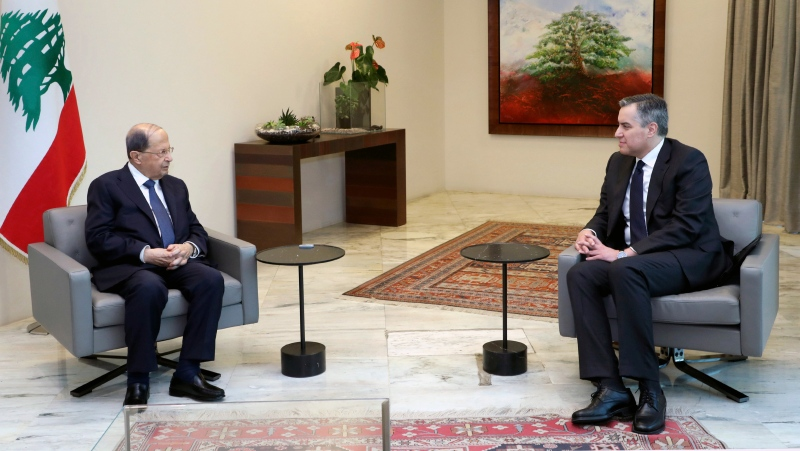 In this photo released by Lebanon's official government photographer Dalati Nohra, Lebanese President Michel Aoun, left, meets with Lebanese Prime Minister-designate Mustapha Adib, at the Presidential Palace in Baabda, east of Beirut, Lebanon, Saturday, Sept. 26, 2020. (Dalati Nohra/Lebanese Government via AP)