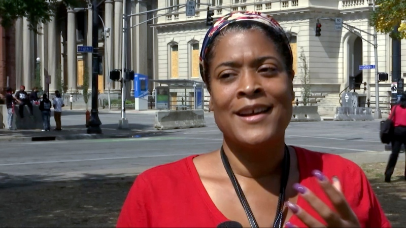 In this image made from video on Sept. 24, 2020, Chea Woolfolk speaks to a reporter on the streets of Louisville, Ky. (AP Photo/Mike Householder)