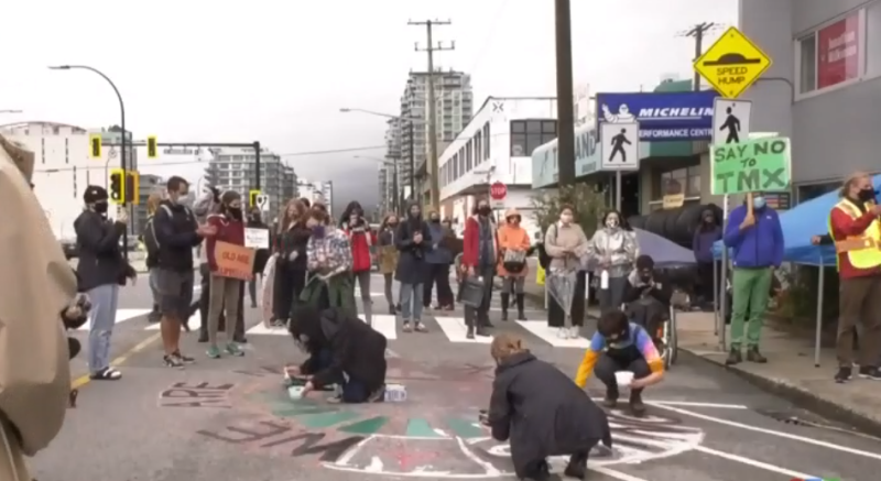 Young protestors rallied outside federal Environment and Climate Change Minister Jonathan Wilkinson's office in North Vancouver on Friday Sept. 25, 2020, to demand that environmental, racial and economic justice be part of the COVID-19 recovery plan.