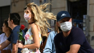 Masks are mandatory in all crowded public spaces in Italy between 6 p.m. to 6 a.m. (AFP)