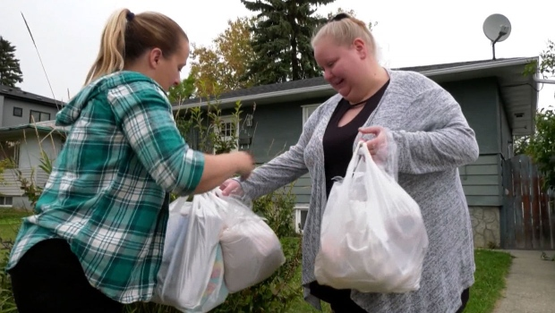 Local community group turns out to support mother in need