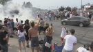 Thousands of car enthusiasts and spectators watch as vehicles do burnouts in Wasaga Beach, Ont., on Sept. 28, 2020 (CTV News Barrie)