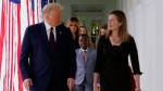 U.S. President Donald Trump walks along the Colonnade with Judge Amy Coney Barrett after a news conference to announce Barrett as his nominee to the Supreme Court, in the Rose Garden at the White House, Saturday, Sept. 26, 2020, in Washington. (AP / Alex Brandon)