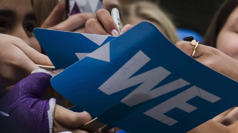 Fans get their sings autographed before the We Day event in Toronto, on Thursday, Sept. 20, 2018. (THE CANADIAN PRESS / Christopher Katsarov)