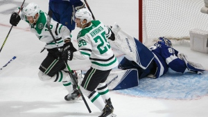 Dallas Stars right wing Corey Perry (10) celebrates his goal against Tampa Bay Lightning goaltender Andrei Vasilevskiy (88) with teammate Joel Kiviranta (25) during the second overtime period NHL Stanley Cup finals action in Edmonton on Saturday, September 26, 2020. (THE CANADIAN PRESS / Jason Franson)