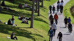 People exercise at a park along the Yarra River in Melbourne a day before lockdown restrictions were to be eased. (AFP)
