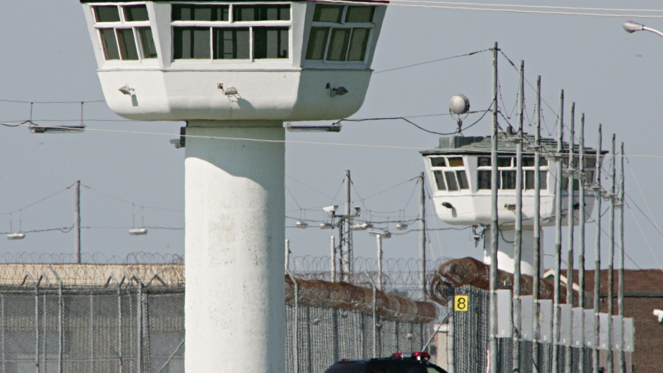 A prison van drives around the Sainte-Anne-des-Plaines institution in Sainte-Anne-des-Plaines, Que., on July 3, 2005. Correctional Service Canada has suspended visits in Quebec's prisons to curb COVID-19 spread. THE CANADIAN PRESS/Jonathan Hayward