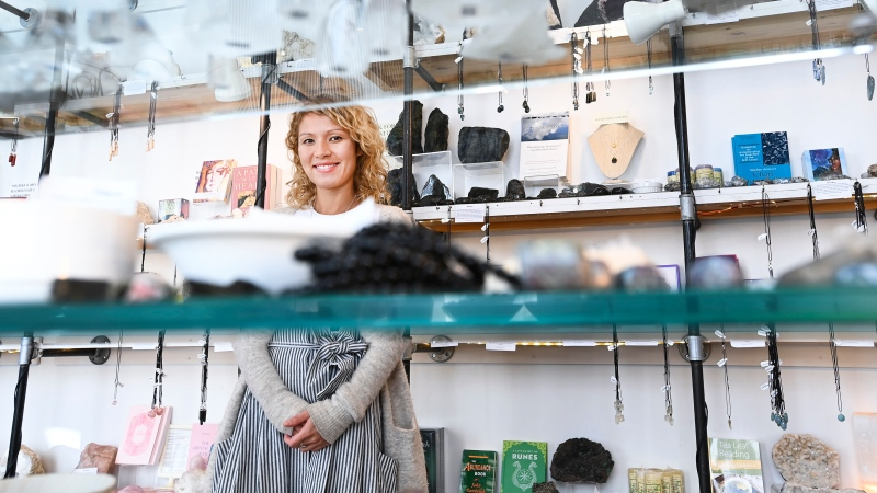 Lady Samantha poses for a photograph at The Rock Store, where she teaches astrology and sell products in Toronto on Friday, September 18, 2020. (THE CANADIAN PRESS / Nathan Denette)