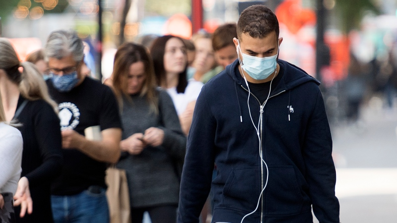 A man wears a face mask as he walks along a street in Montreal, Saturday, September 26, 2020, as the COVID-19 pandemic continues in Canada and around the world.THE CANADIAN PRESS/Graham Hughes
