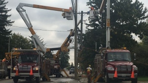 London Hydro crews repair damaged poles following an alleged impaired driving crash on Hamilton Road on Sept. 27, 2020. (Brent Lale/CTV London)