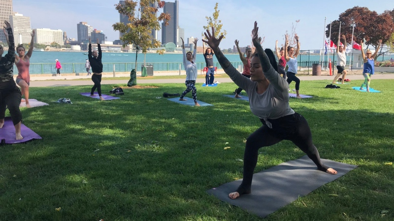 People practicing yoga at the riverfront for Transition to Betterness Yoga 4 Hope event in Windsor, Ont. on Sunday, Sept. 27 2020. (Alana Hadadean/CTV Windsor)