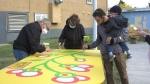 Painting a mural that will be displayed outside the Inglewood Community Hall. Sunday Sept. 27, 2020 (CTV News Edmonton)