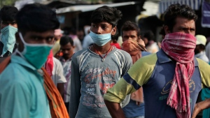 Migrant laborers from other states looking for work gather on a street on the outskirts of Jammu, India, Sunday, Sept.27, 2020. The nation of 1.3 billion people is expected to become the coronavirus pandemic's worst-hit country within weeks, surpassing the United States. (AP Photo/Channi Anand)