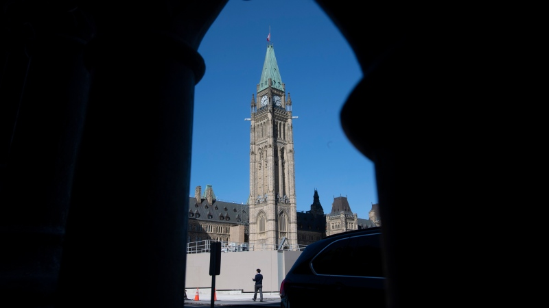 A man walks outside Parliament buildings in Ottawa, Monday September 21, 2020. (THE CANADIAN PRESS/Adrian Wyld)