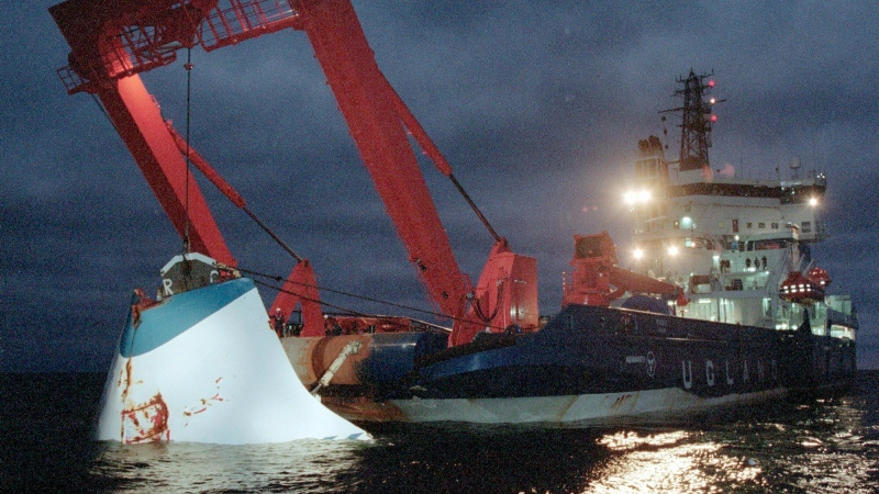 In this Nov. 19, 1994 file photo, the bow door of the sunken passenger ferry M/S Estonia is lifted up from the bottom of the sea, off Uto Island, in the Baltic Sea. (Jaakko Aiikainen/Lehtikuva FILE via AP)