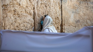With social distancing barrier, an ultra-Orthodox Jewish man prays ahead of Yom Kippur at the Western Wall in Jerusalem's Old City, on Sept. 27, 2020. (Ariel Schalit / AP)