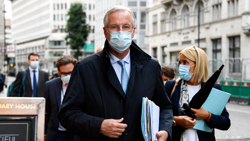 Chief EU negotiator Michel Barnier makes his way to the Department for Business, Energy & Industrial Strategy, in London, Wednesday, Sept. 23, 2020. (AP Photo/Alberto Pezzali)