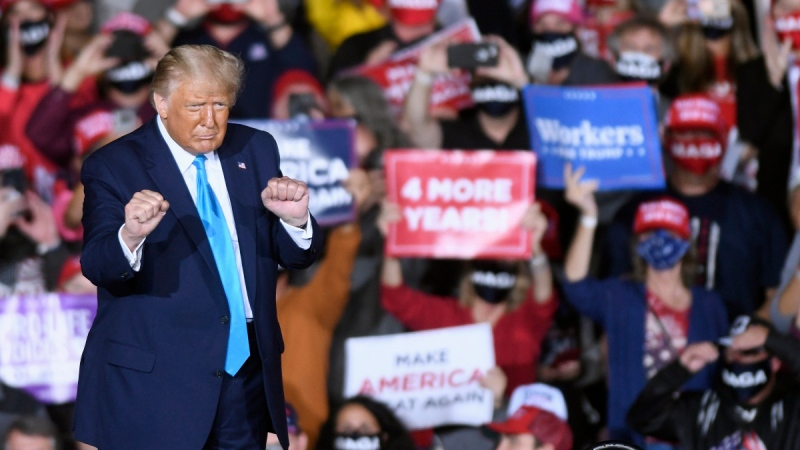 U.S. President Donald Trump dances during a campaign rally at Harrisburg International Airport in Middletown, Pa, on Sept. 26, 2020. (Steve Ruark / AP)