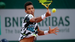 Felix Auger-Aliassime plays Yoshihito Nishioka in the first round match of the French Open in Paris, on Sept. 28, 2020. (Christophe Ena / AP)