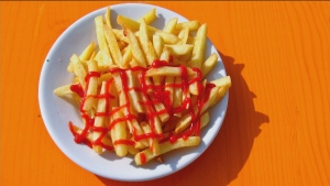 Ketchup on the side or all over fries, which is be