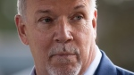 NDP Leader John Horgan pauses while speaking during a campaign stop in Coquitlam, B.C., on Friday, September 25, 2020. THE CANADIAN PRESS/Darryl Dyck