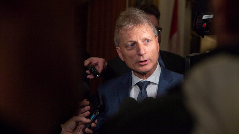 New Brunswick MLA Roger Melanson speaks to the media following the Throne Speech at the New Brunswick Legislature in Fredericton on Tuesday, Oct. 23, 2018. (THE CANADIAN PRESS/James West)