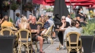 People are shown on an outdoor terrace in Old Montreal, Sunday, September 27, 2020, as the COVID-19 pandemic continues in Canada and around the world. THE CANADIAN PRESS/Graham Hughes