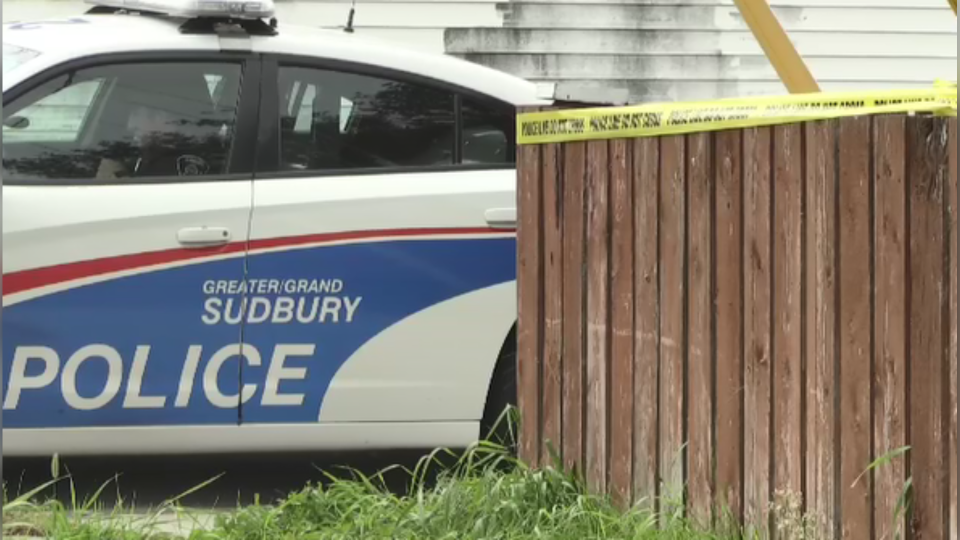 Sudbury police officer sits in patrol car outside Flour Mill home cordoned off after the death of a adult male. Sept. 27/20 (Molly Frommer/CTV Northern Ontario)