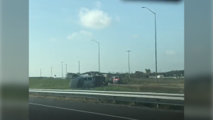 A tow truck rollover on the 400 southbound sends one person to a Toronto hospital in life-threatening condition on Sept 28, 2020 (Mike Arsalides/CTV News)