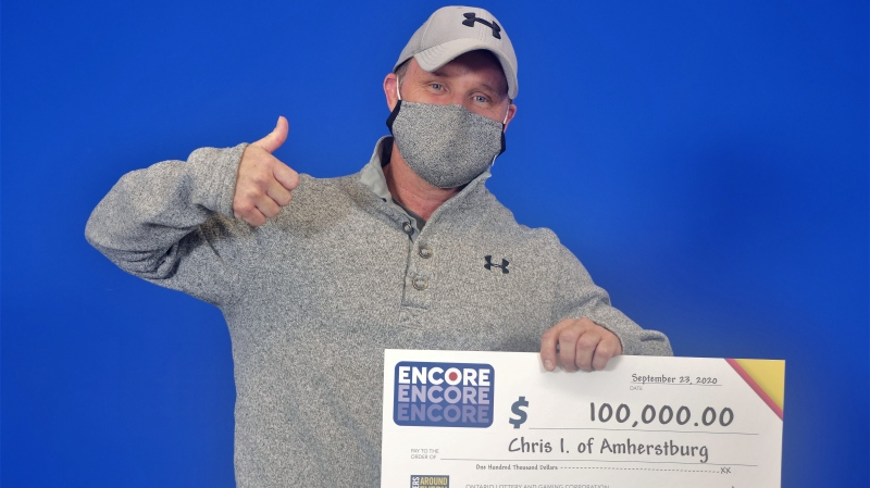 Chris Inch of Amherstburg show off his earnings. (Courtest OLG)