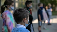 Masked schoolchildren are seen here at Rogers International School in Stamford, Conn. (AFP)