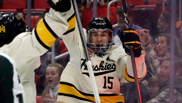 Michigan Tech forward Jake Lucchini (15) reacts after scoring during the second period of a Great Lakes Invitational college hockey game against Michigan State, Monday, Jan. 1, 2018, in Detroit. (AP Photo/Carlos Osorio)