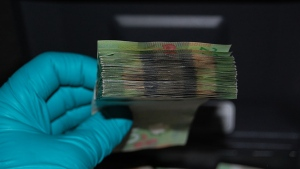 Coquitlam RCMP are looking for the rightful owner of a wad of cash-- similar to this one pictured here-- that was left behind at a Tim Hortons in June. (RCMP handout)