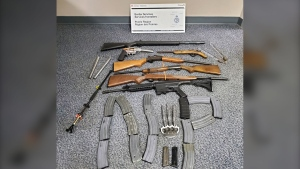 Guns, weapons and magazines seized by the Canada Border Services Agency at the North Portal, Sask. border crossing during a search on June 30. (Courtesy: CBSA)