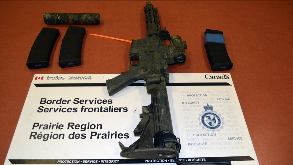 An AR-15, three prohibited magazines and a silencer seized at the North Portal, Sask. border crossing on July 21. (Courtesy: Canada Border Services Agency)