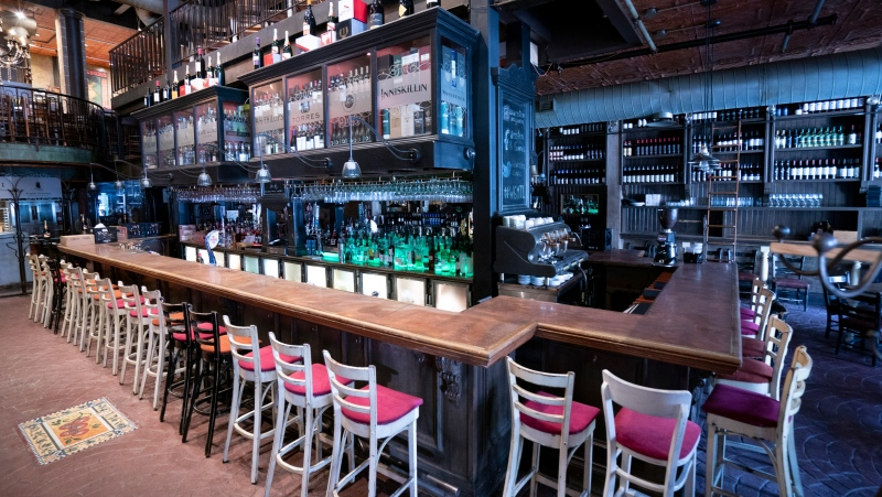 The empty bar is seen at the W&G Restaurant on Montreal's popular Crescent Street, on Monday, June 8, 2020. The Quebec government has yet to announce the opening of restaurants and bars in the province. THE CANADIAN PRESS/Paul Chiasson