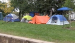 A group of homeless people are camping out in tents in front of North Bay city hall to raise awareness of the ongoing homeless situation in the city. (Eric Taschner/CTV News)