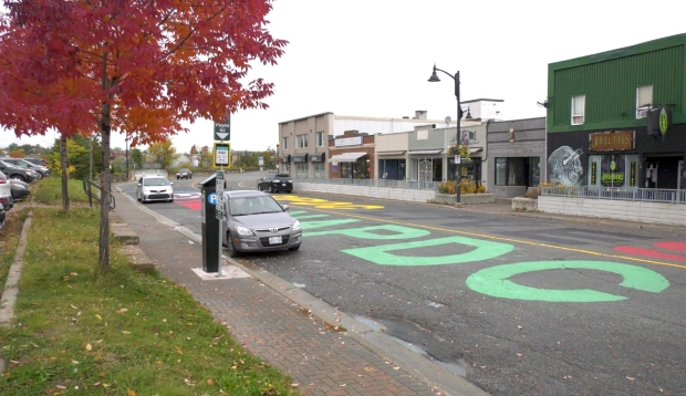 """Sudburians woke up Monday morning to find their commute across Elgin Street looking a little different. One of Sudbury's more busier streets had the words """"BIPOC LIVES MATTER"""" painted across it in both official languages. (Ian Campbell/CTV News)"""