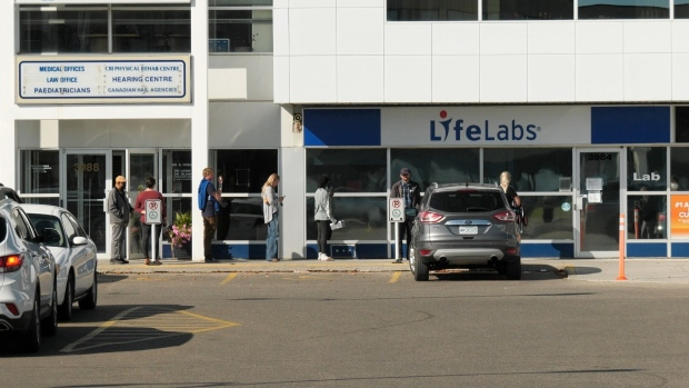 People wait outside LifeLabs in Regina. (Marc Smith/CTV Regina)