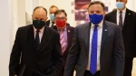 Quebec Premier Francois Legault arrives at a news conference flanked by Health Minister Christian Dube, left and Dr. Horacio Arruda, Quebec's director of public health, in Montreal, on Monday, September 28, 2020. THE CANADIAN PRESS/Paul Chiasson