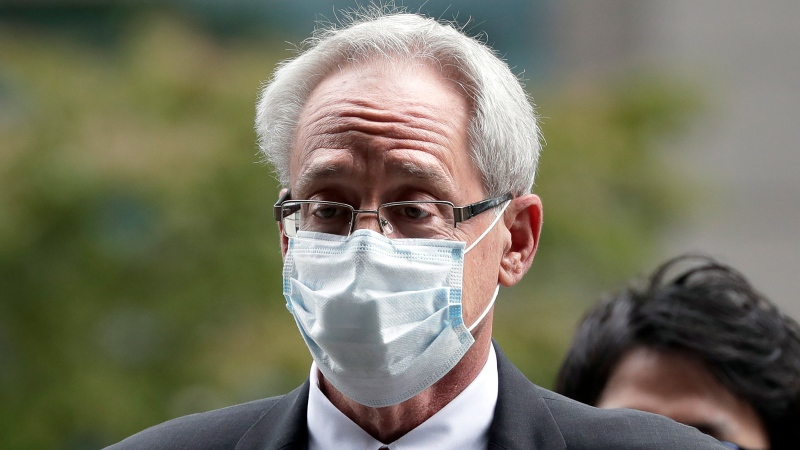 In this Sept. 15, 2020, file photo, former Nissan Motor Co. executive Greg Kelly arrives for the first trial hearing at the Tokyo District Court in Tokyo. (Kiyoshi Ota/Pool Photo via AP, File)
