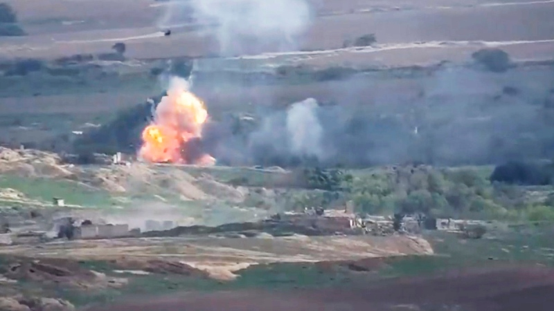This image taken from a video released by Armenian Defense Ministry on Sept. 28, 2020 allegedly shows fighting between Armenian and Azerbaijani forces at the contact line of the self-proclaimed Republic of Nagorno-Karabakh, Azerbaijan. (Armenian Defense Ministry via AP)