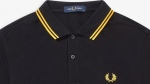 British apparel-maker Fred Perry has pulled a polo shirt from the US market after it became associated with the far-right group the Proud Boys. (Fred Perry/CNN)