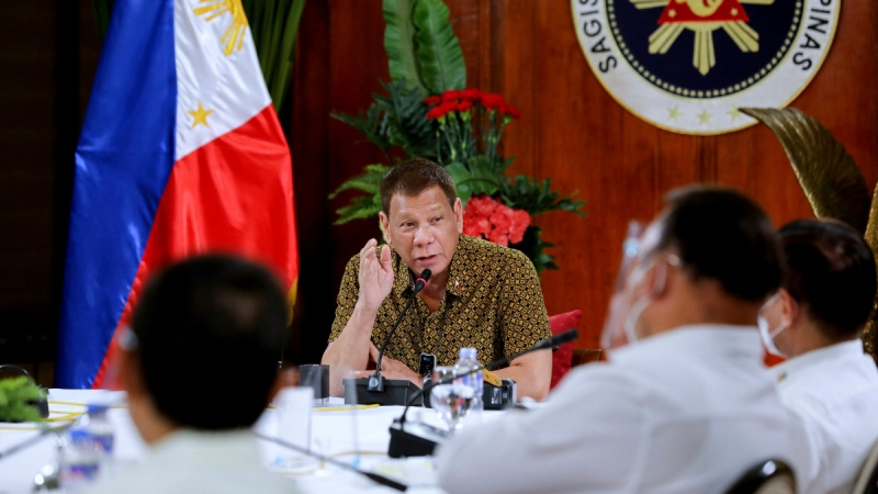Philippines President Rodrigo Duterte, centre, meets members of the Inter-Agency Task Force on the Emerging Infectious Diseases at the Malacanang presidential palace in Manila, Philippines, on Sept. 28, 2020. (Robinson Ninal Jr./Malacanang Presidential Photographers Division via AP)