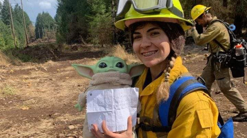 The firefighters now bring Baby Yoda with them everywhere and even document his travels in a Facebook group -- with more than 20,000 followers -- so that Carver and others can see how much Baby Yoda has helped them along the way. (Courtesy Tyler Eubanks/CNN)